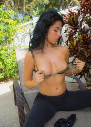 Sexy amateur dame slips out of her yoga pants and thong undergarments