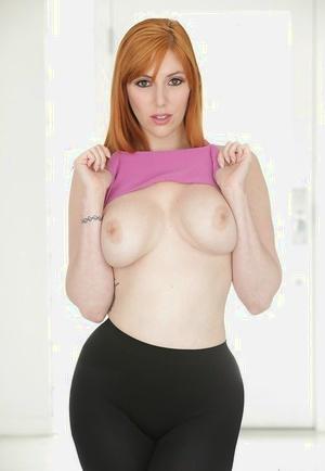 Redhead pornstar Lauren Phillips baring adorable bra-stuffers before shedding yoga pants