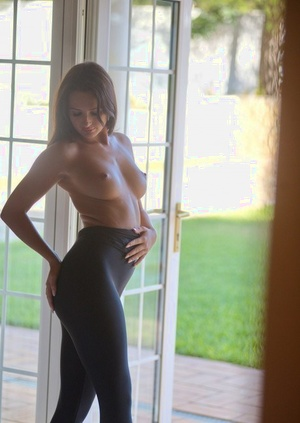 Nude female Gina Barrett pulls on skintight riding pants with walkout door open